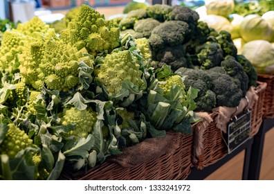 Romanesque broccoli and common broccoli, for sale in a supermarket.