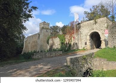 """The Romanesque castle complex of the Eckartsburg in Saxony-Anhalt in Germany; the text on the banner means """"Foundation Cathedrals and Castles in Saxony-Anhalt, on the sign """"Romanesque Road"""""""