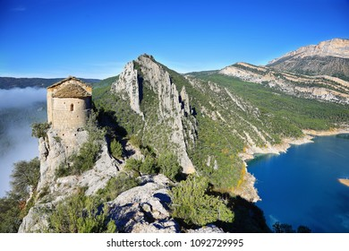 Romanesque Chapel of Mare de Deu de la Pertusa over the Canelles reservoir in Lleida, Catalonia, Spain.