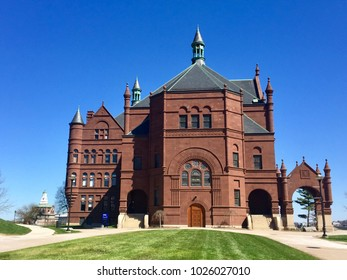 Romanesque Crouse College building in Syracuse University campus against a blue sky in Syracuse, New York.