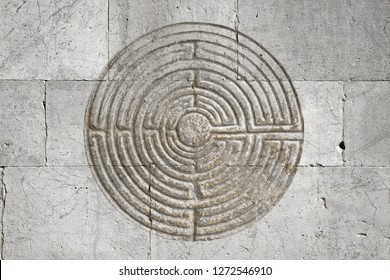Romanesque labyrinth carved on a stone wall - concept image