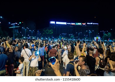 Romania, Bucharest - August 10, 2018: Protesters raising phone light torches in Victoria Square during violent protest