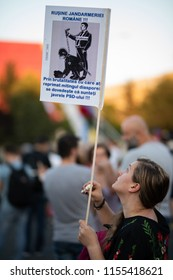 Romania, Bucharest - August 12, 2018: Protester holding sign and teardrops after the citizens were gased. Protesting against violent police that beat innocent people days before
