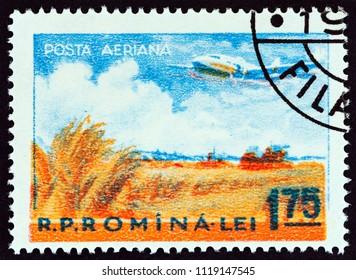 ROMANIA - CIRCA 1956: A stamp printed in Romania shows Ilyushin Il-18 over cornfield, circa 1956.