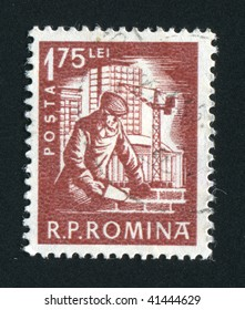 ROMANIA - CIRCA 1957: The worker builds the big house, circa 1957.