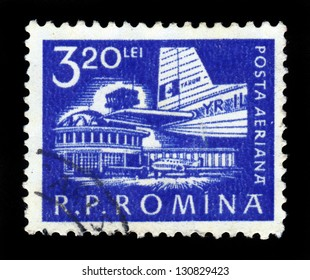 ROMANIA - CIRCA 1960: A stamp printed in Romania shows Bucharest airport and tail of an aircraft ilyushin IL-14, circa 1960