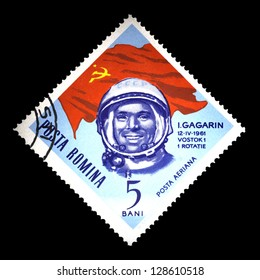 """ROMANIA - CIRCA 1963: A stamp printed in Romania shows USSR flag and portrait of astronaut Yuri Gagarin, with the same inscription, from the series """"Space Navigation"""", circa 1963"""