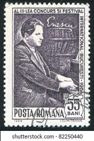 ROMANIA - CIRCA 1964: A stamp printed by Romania, shows Enescu at piano, circa 1964.