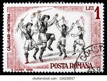ROMANIA - CIRCA 1966: a stamp printed in the Romania shows Folk Dancers of Muntenia, Traditional Folk Dance, circa 1966