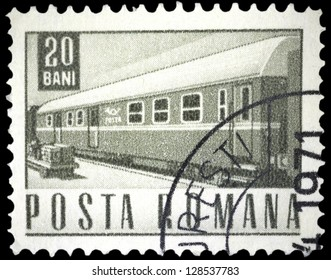 """ROMANIA - CIRCA 1967: A stamp printed in Romania shows a Railway traveling post office coach, without inscription, from the series """"Postal and transport"""", circa 1967"""