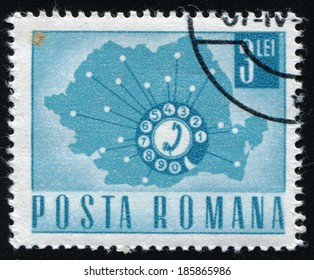 ROMANIA - CIRCA 1967: A stamp printed in Romania shows a Telephone Dial and Map of Romania, circa 1967