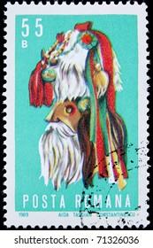 ROMANIA - CIRCA 1969: A post stamp printed in Romania shows a mask, circa 1969.