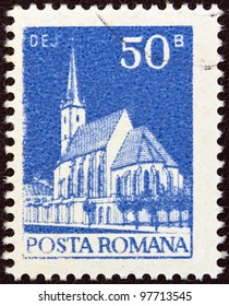 "ROMANIA - CIRCA 1974: A stamp printed in Romania from the ""Buildings"" issue shows the Reformed Church, Dej, circa 1974."