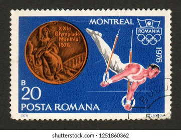 ROMANIA - CIRCA 1976: A postage stamp printed in Romania shows gymnast Dan Grecu, winner of the still rings bronze medal at the 1976 Montreal summer Olympics.