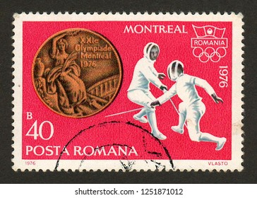 ROMANIA - CIRCA 1976: A postage stamp printed in Romania shows a fencing scene and the bronze medal won by the men's sabre team at the 1976 Montreal summer Olympics.