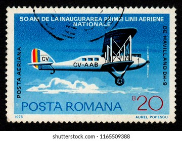 ROMANIA – CIRCA 1976:  A stamp printed in Romania shows an image of an DE HAVILLAND DH-9 plane as part of a series celebrating 50 years from the inauguration of the first national air route.