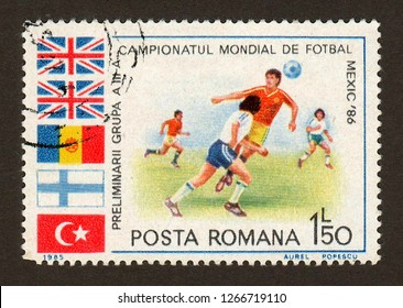 ROMANIA - CIRCA 1985: A postage stamp printed in Romania shows a football (soccer) scene in a series dedicated to the preliminaries of the 3rd group of the 1986 FIFA World Cup in Mexico.