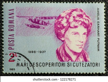 ROMANIA - CIRCA 1985: A stamp printed in Romania shows Amelia Earhart Putnam, first woman who flew solo across the Atlantic Ocean in 1928, circa 1985
