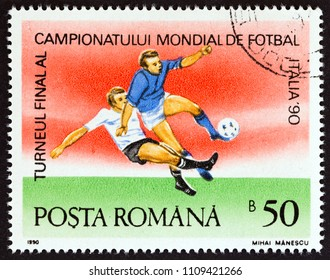 """ROMANIA - CIRCA 1990: A stamp printed in Romania from the """"Football World Cup - Italy"""" issue shows football match, circa 1990."""