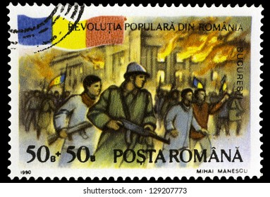 """ROMANIA - CIRCA 1990: A stamp printed in Romania, shows Palace on fire, with inscription """"Bucharest"""", from the series """"First Anniversary of December 1989 Revolution"""", circa 1990"""