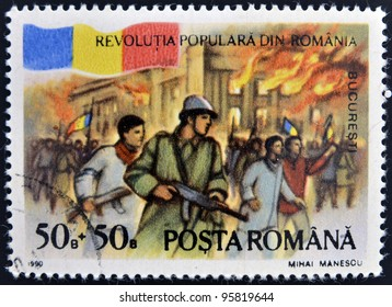 ROMANIA - CIRCA 1990: stamp printed in Romania dedicated to popular revolution shows Palace on fire, Bucharest, circa 1990