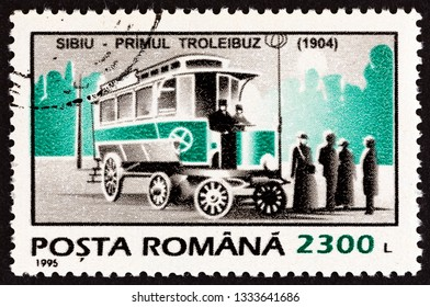 """ROMANIA - CIRCA 1995: A stamp printed in Romania from the """"Means of Transport"""" issue shows the first trolleybus, 1904, Sibiu, circa 1995."""