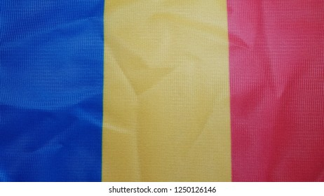 romania flag on cloth, blue, yellow and red flag closeup