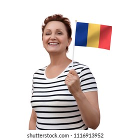 Romania flag. Woman holding Romanian flag. Nice portrait of middle aged lady 40 50 years old with a national flag isolated on white background.Learn Romanian language. Visit Romania concept.