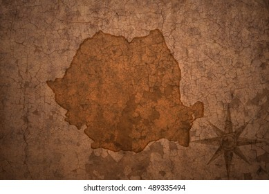 romania map on a old vintage crack paper background