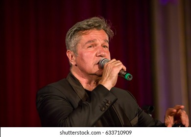 ROMANIA - March 22, 2017: Dan Bitman lead singer of the Holograf band performs onstage at the Gala Nationala a Excelentei in asistenta sociala at Romanian Athenaeum in Bucharest.