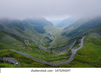 Romania, Romanian Carpathians - Fagaras Mountains, view from Balea Lac on the zigzag road (bends) of the Transfagarasan Highway road in low clouds