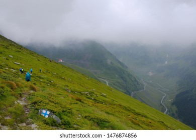 Romania, Romanian Carpathians,  Fagaras Mountains - tourists on a tourist trail, descending in low clouds to the Transfagarasan Highway in the Paltin Mountains.