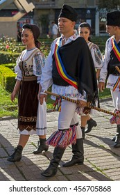 """ROMANIA, TIMISOARA - JULY 7, 2016: Dancers from Romania in traditional costume, present at the international folk festival, """"International Festival of hearts"""" organized by the City Hall Timisoara."""