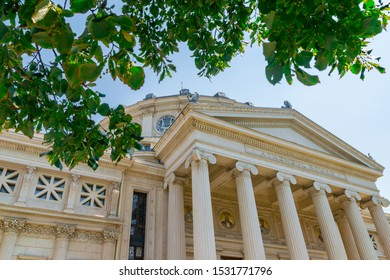 Romanian Athenaeum, a concert hall in the center of Bucharest, Romania and a landmark of the Romanian capital city. Romanian Athenaeum a sunny summer day with blue sky in Bucharest, Romania.