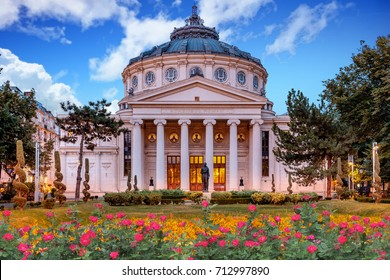 Romanian Atheneum, an important concert hall and a landmark in Bucharest, Romania. Sunset colors in autumn with blue sky.