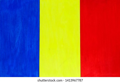 Romanian flag background - Romania's national colors on a wooden background.