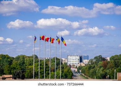Romanian national flags waving in the wind on top of the hill in Carol Park, Bucharest, Romania