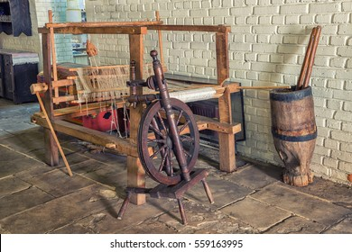 Romanian old age wooden loom machine for making cloths and fabrics totally manually handled, and a manually operated mill machinery