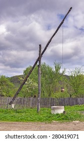 Romanian old wooden water well in the countryside