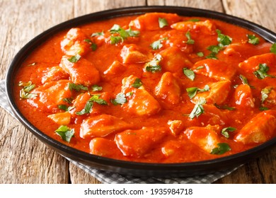 Romanian Ostropel Chicken with Garlicky Tomato Gravy closeup in the plate on the table. Horizontal - Shutterstock ID 1935984718
