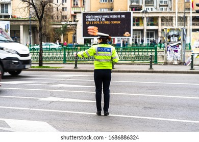 Romanian Police (Politia Rutiera) directing traffic and patrolling streets to avoid curfew breaches amid the spread of the Coronavirus COVID-19 in downtown Bucharest, Romania, 2020
