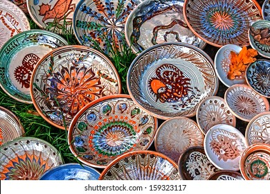 Romanian traditional ceramic in the plates form, painted with specific motifs Horezu area.