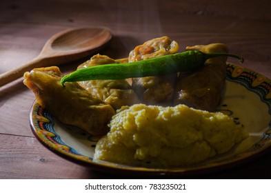 Romanian traditional dish. Corn porridge with stuffed sour cabbage