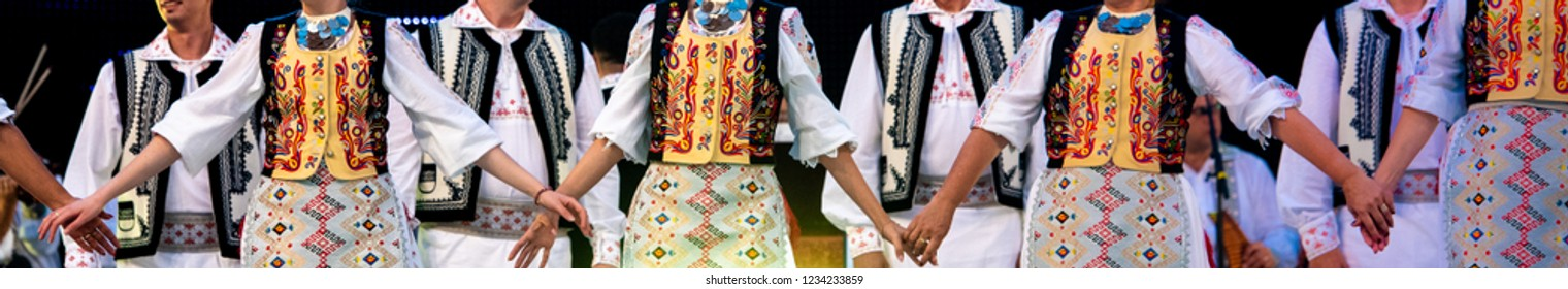 Romanian traditional folkloric costumes and dancers