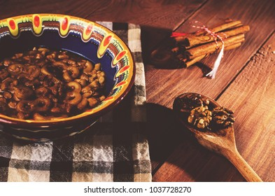 """Romanian traditional food called  martyrs """"mucenici, macinici"""", eight shape made from flour with sugar, walnuts and cinnamon"""