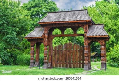 Romanian traditional wooden door from Maramures area in Herastrau park, Bucharest