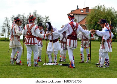 """Romanian Whitsuntide tradition - men wearing rustic """"ia"""" clothes performing old dance - elder traditions of """"Rusalii"""" in Dragasani, Dolj / Romania - 5/28/2018"""