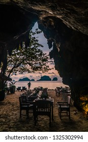 Romanic dinner in a candlelit restaurant inside a cave, on the beach. Fine Dining concept. Unique places to eat. Proposal location. Shot in Krabi, Thailand, Asia.