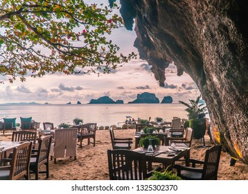 Romanic dinner in a restaurant in a cave, on the beach. Fine Dining concept. Unique places to eat. Proposal location. Shot in Krabi, Thailand, Asia.