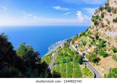 Romanic road at vineyards and Mountains at Agerola and Blue Mediterranean Sea in Italy. Landscape at Italian coast. Panorama of Amalfi coast in Europe. View in summer. Beautiful scenery at Amalfitana.